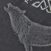 Illustration of wolf hand carved onto a plaque.