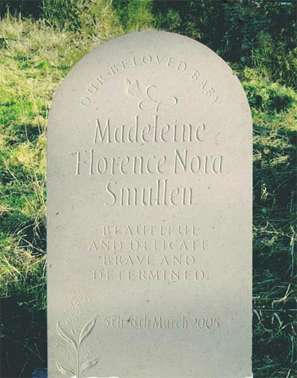 Childs Headstone example with Butterfly and Flowers.