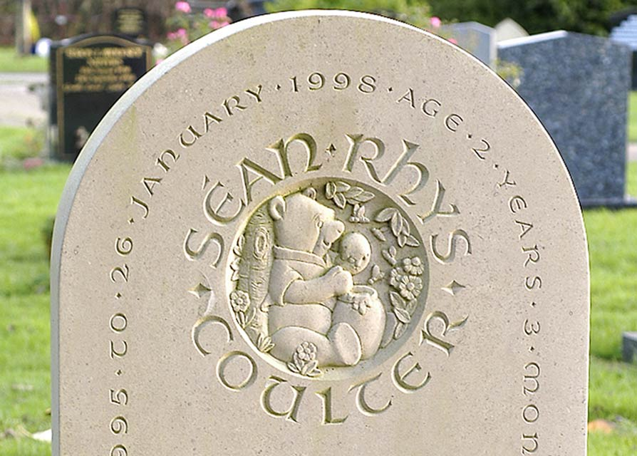 Childrens Headstone example with Winnie the Poo and Honey Pot.
