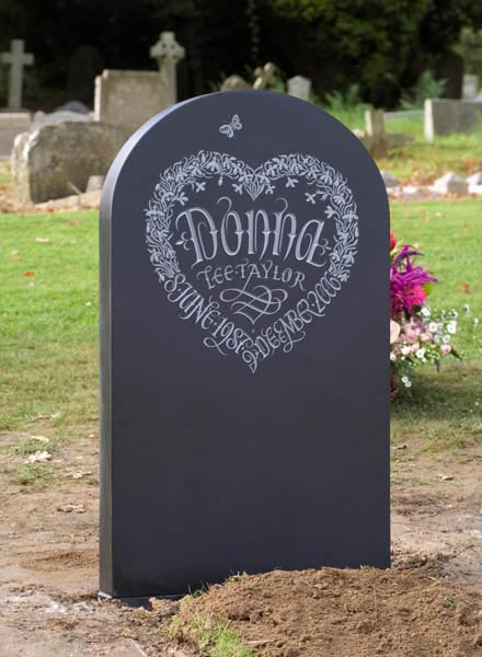 Decorative Headstone example with hand carved butterly and flowers.