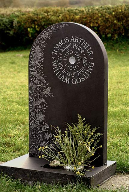 Decorative Headstone example with flowers, leaves and birds.