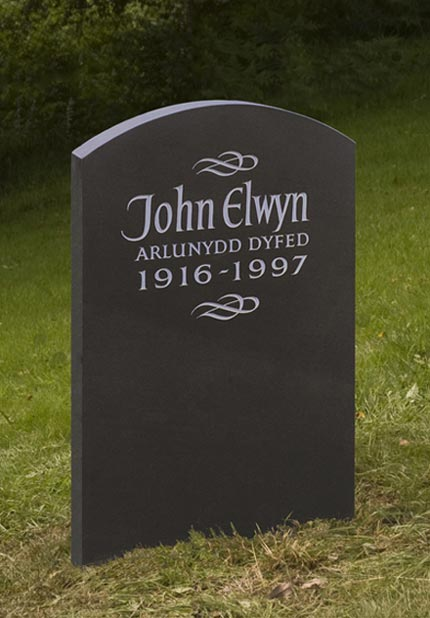 Simple and Dignified Headstone example with flowing detail.