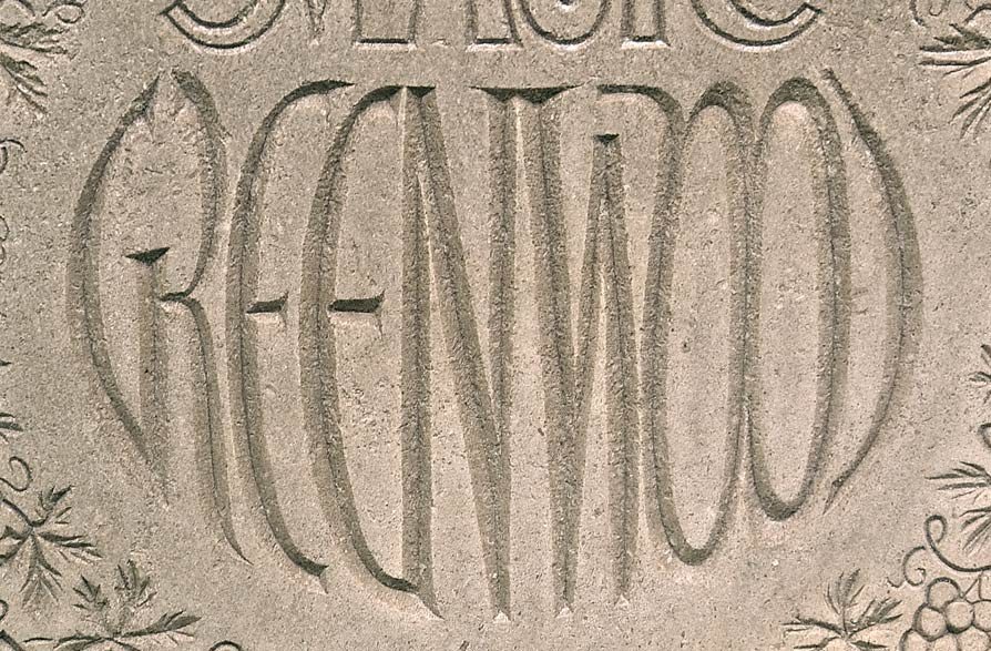 Headstone detail with Curved text.