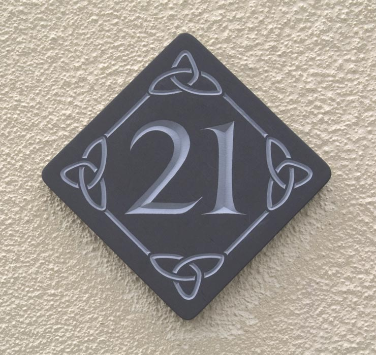 Celtic knotwork details surrounding house number.