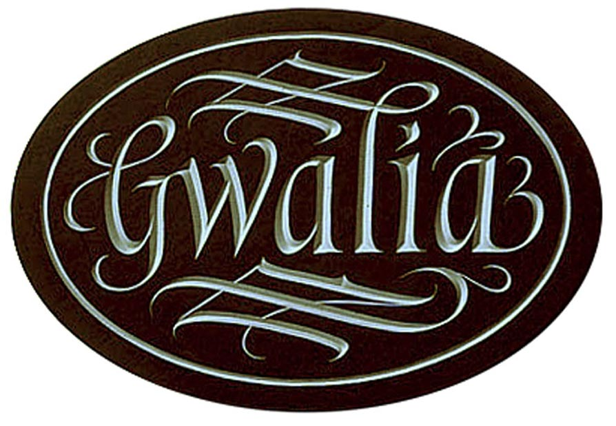 Flowing design on oval nameplate.
